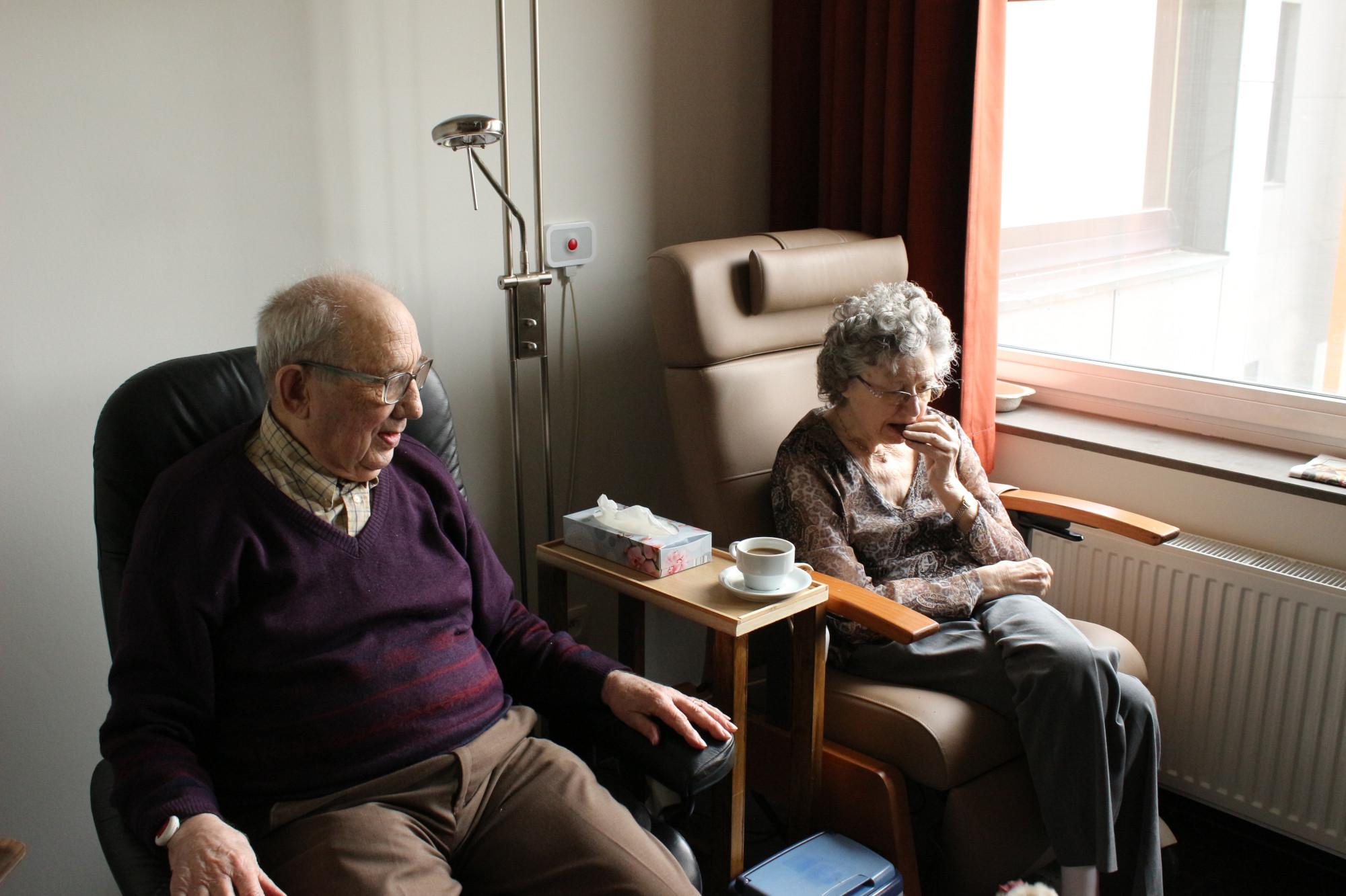 Two elders sitting side by side