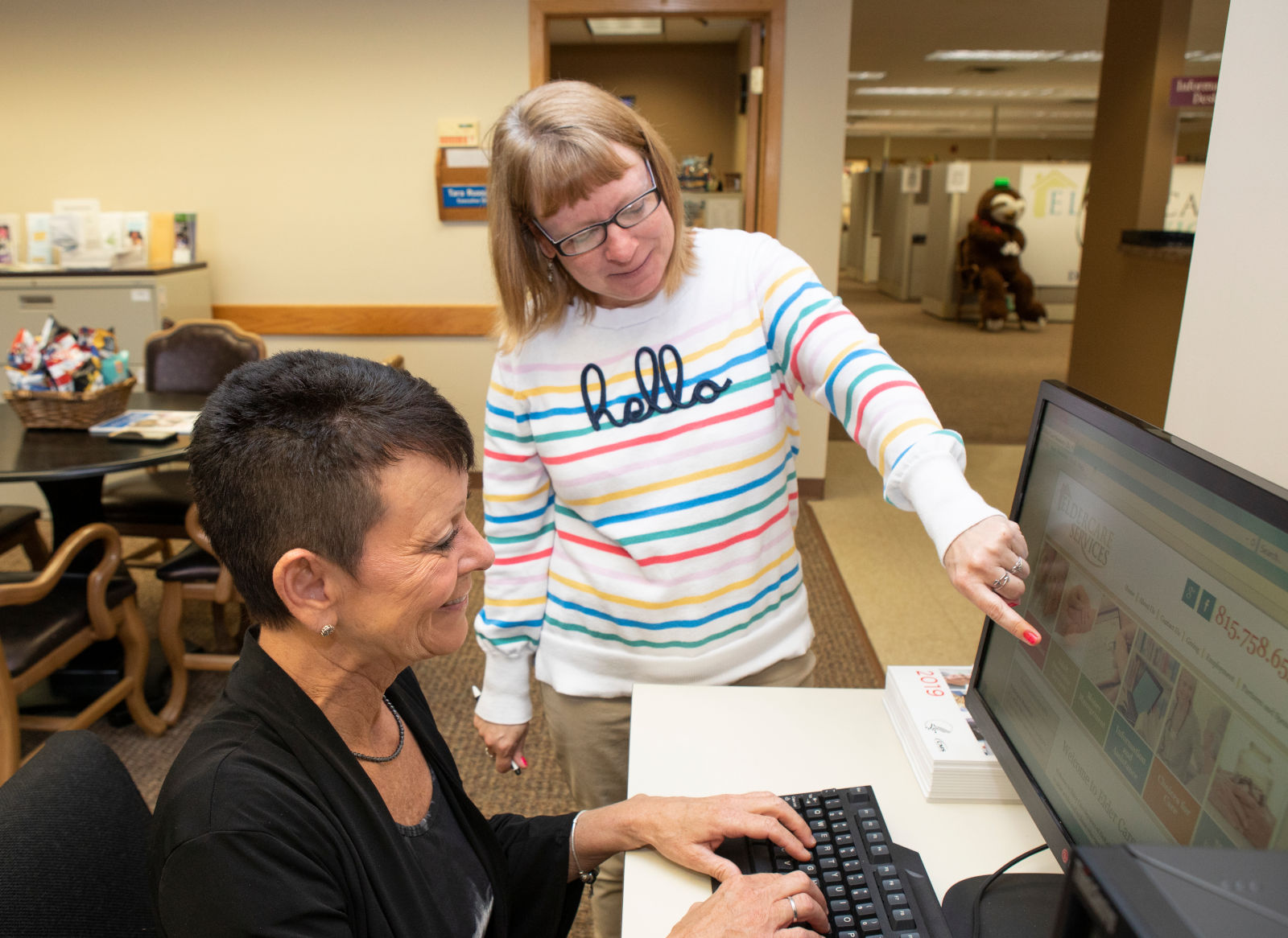 Elder Care Services employees working together at a computer